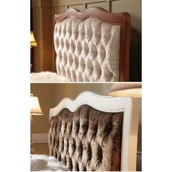 Cama con cabecero tapizado...